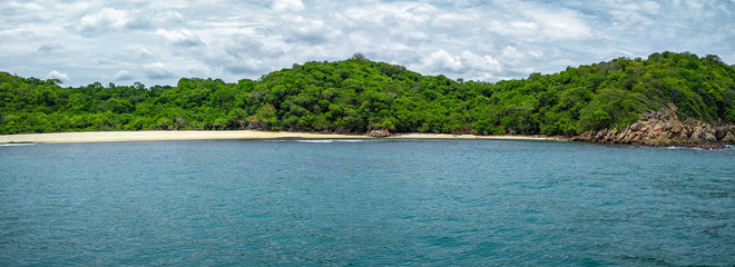 A panorama of Bahia Riscalillo at Hautulco National Park in Oaxaca. Travel in Mexico, Pacific Ocean.