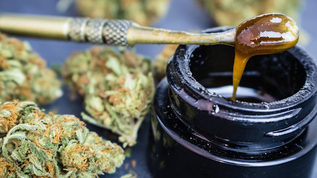 Marijuana with THC/CBD oil extract on dab tool