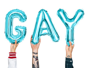 Blue alphabet balloons forming the word gay