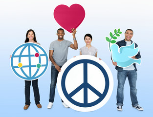 Happy diverse people holding world peace icons