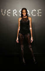 Model Winnie Harlow poses for a photo before attending the Versace presentation in New York