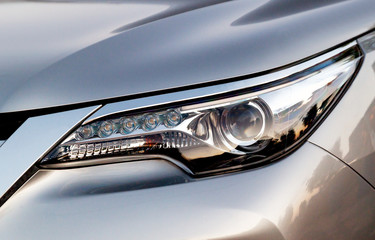 Car's exterior details. Close up detail LED headlights on a modern car.