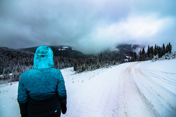 girl looks at ski mountain after it got it first snow of the season