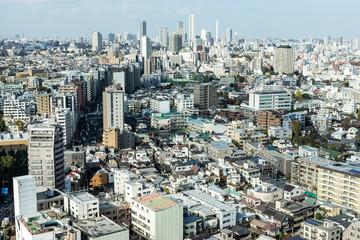 Spoed Foto op Canvas Tokyo 東京後楽園から望む池袋方面