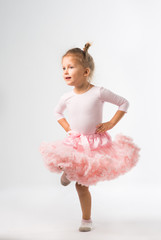The little girl of four years is engaged in dancing