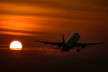 Plane take off in evening with sunset