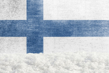 Winter grunge background with snowdrift and Finnish flag in the backdrop