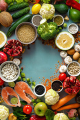 Frame healthy food cereals seeds fish vegetables fruits stone background top view
