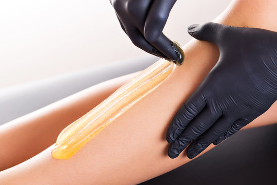 Hair removal process on female leg with epilation