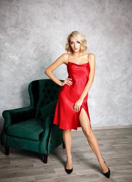 Beautiful woman in a sexy red dress