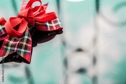 A Red Ribbon In The Box Of Fabric On A Dark Mirrored Background