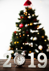 New Year number on table with clock and christmas tree