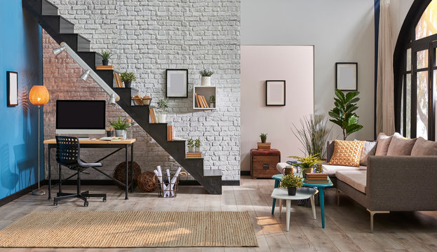 modern living room, grey sofa, wooden desk and desktop, black stairs and white brick wall concept. Frame book and room ornament style.