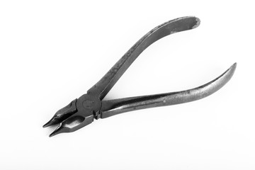 Old metal pliers on a light background