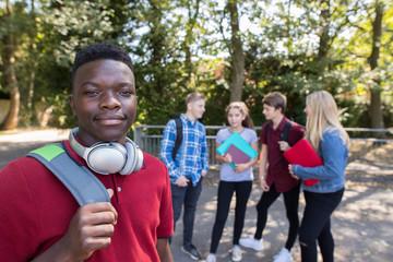Portrait Of Teenage Students Outside School Building