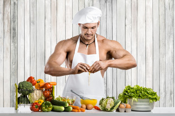 Man bodybuilder on kitchen