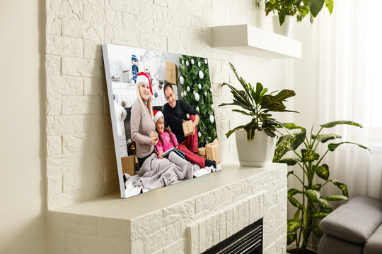 large wall canvas portrait of her family with young children
