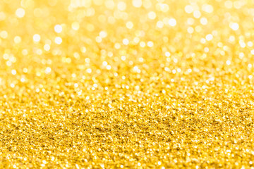 Gold glitter close-up background with shallow depth of field