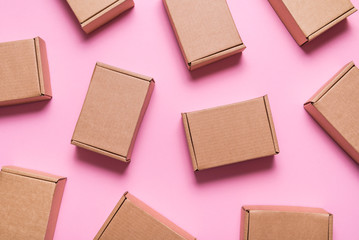 Obraz Lot of cardboard boxes on pink background - fototapety do salonu