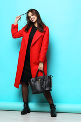 Fashion woman in red coat.