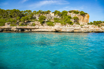 Mallorca in Balearic Islands, Spain. One of the most beautiful beach in the world with crystal clear turquoise waters and a wonderful paradise in the middle of the Mediterranean sea in Europe.
