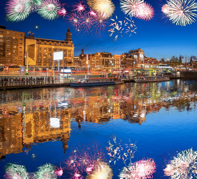 Amsterdam with firework (celebration of the New Year) in Holland