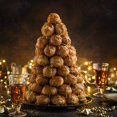 croquembouche, festive profiteroles cake with caramel for Christmas