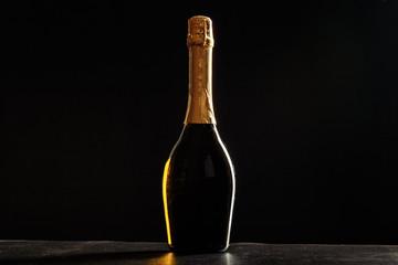 Bottle of champagne on black background.