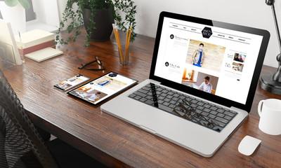 devices blog on wooden desktop