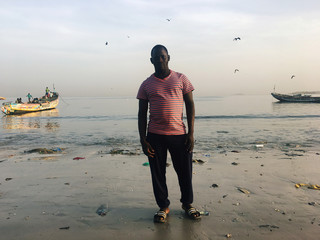 Assane Diallo, a migrant who is preparing to travel by boat from Senegal to the Canary Islands, poses for photograph in Daka