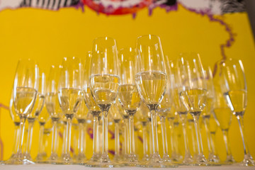 Glass with champagne on wedding table