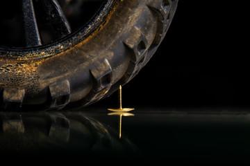 Automotive wheel hits the nail