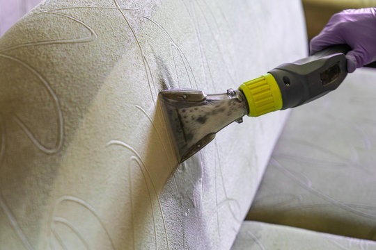Closeup of upholstered Sofa chemical cleaning