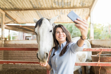 Rancher Capturing Memories While Feeding Horse
