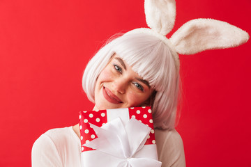 Cheerful young girl wearing Christmas bunny ears