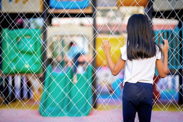 Child girl watching friends play at the playground
