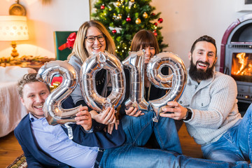 Happy people, friends celebrating new year 2019