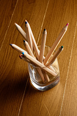 Pencils in glass