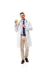 handsome doctor pointing with finger at apple isolated on white, healthy eating concept