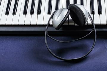 Headphones on piano keyboard