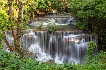 Waterfall flowing from the mountains at Huay Mae khamin waterfall National Park ,Kanchana buri in Thailand.