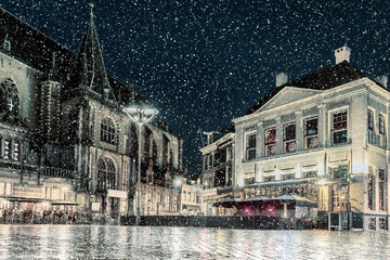 Winter view with snowfall of the Dutch central square in the city of Zwolle