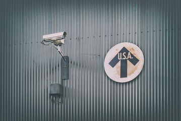 Surveillance camera with vintage USA direction sign