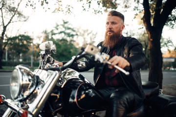 Biker sitting on a motorcycle, classical chopper