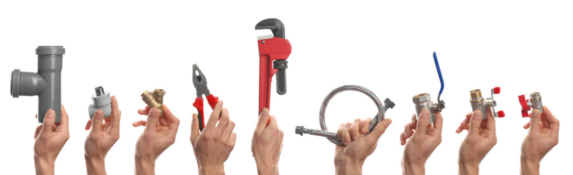 Plumbers holding different tools and fittings on white background