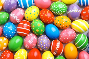Many decorated Easter eggs as background, top view. Festive tradition