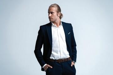 Portrait of handsome man in dark blue suit.
