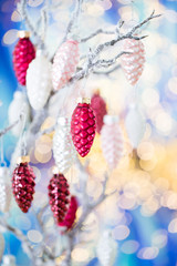 Christmas greeting card. Pine decoration on bokeh background. New Year concept. Copy space.