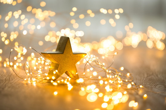 Christmas greeting card. Christmas stars decoration on bokeh background. New Year concept. Copy space.
