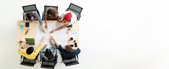 Header or banner of top view of creative diverse people. Overhead view of young creative team, start up colleagues group or college student meeting and voting agree opinion by pointing hands at desk.